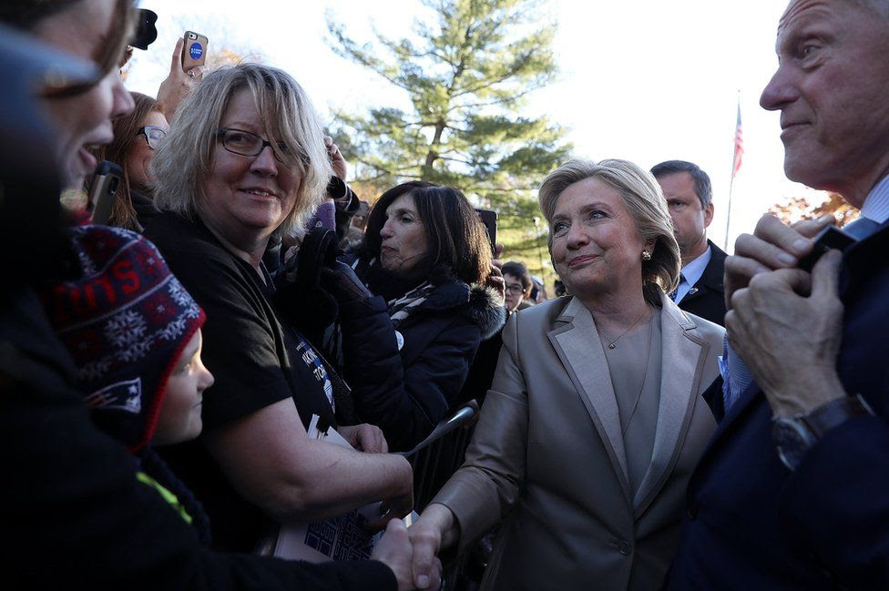 Democratic presidential nominee former Secretary of State Hillary Clinton greets supporters after voting at Douglas Grafflin Elementary School in Chappaqua, New York