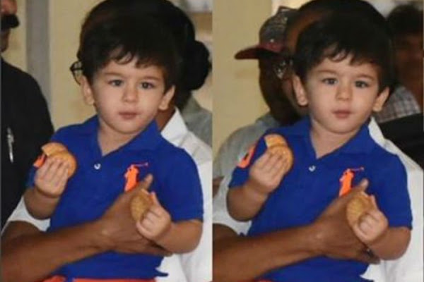 da70ebb4c7f Cutie Taimur Ali Khan has his hands full with cookies as he steps out with  his nanny - video inside