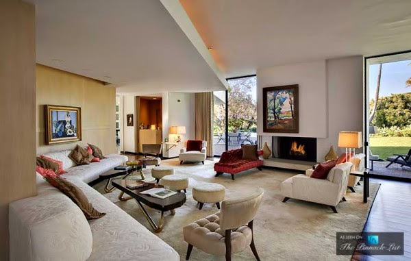 Pristine décor in predominantly neutral shades fills each of the rooms, peppered with warming red as a welcoming accent color.