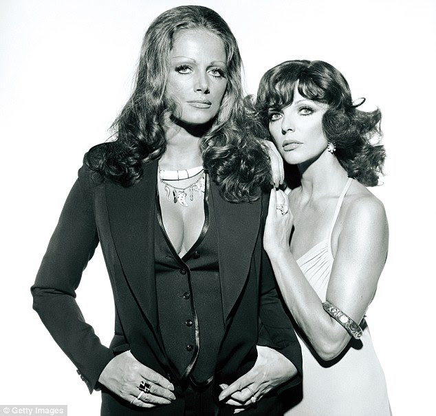 Joan with sister Jackie in 1974. Joan admits she is more conscious of her mortality since the loss of her younger sister Jackie, the novelist, to breast cancer last year
