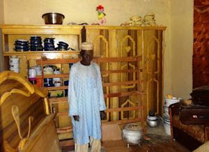 Sani Garba, 55, stands in the abandonned bedroom of …