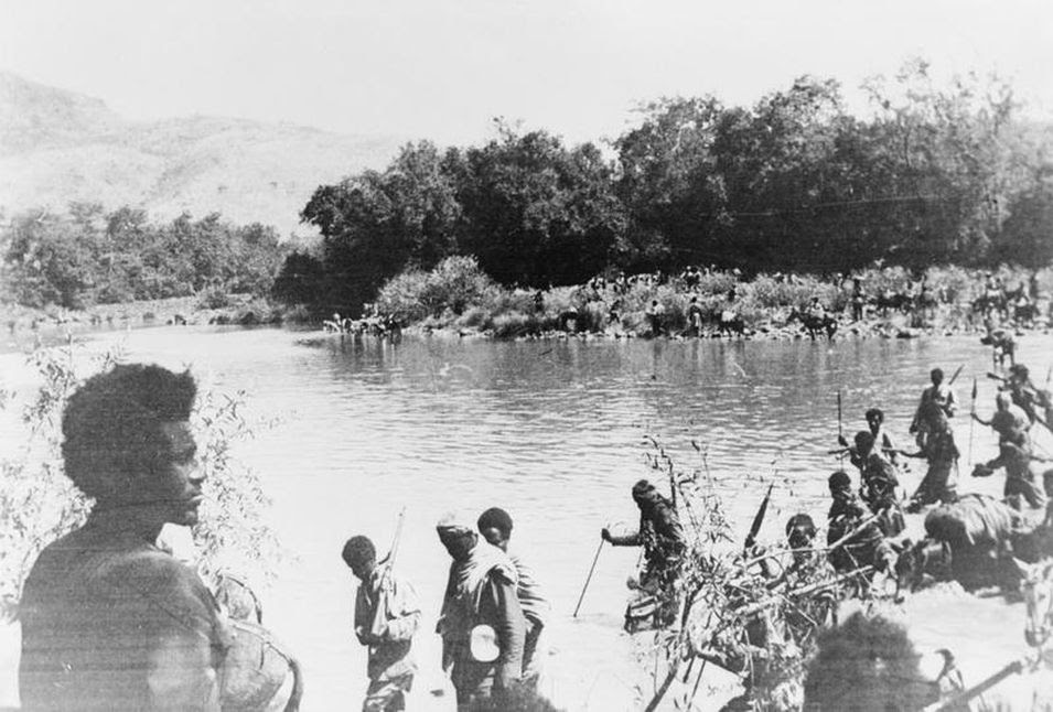 In magnificent silhouette, Dej. Geresu Duki watches his army cross the Omo river into Italian territory (circa 1936-1941)