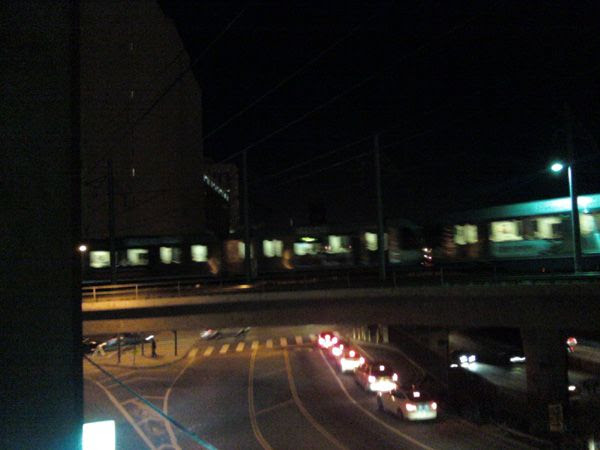 A Metro Gold Line train is about to pass over the 101 Freeway in downtown Los Angeles, on February 14, 2014.