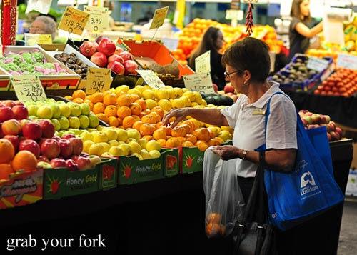 customer buying fruit
