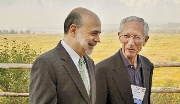 Fischer and Bernanke laugh at the Jackson Hole, Wy. monetary policy summit last summer. (Ted S. Warren / AP)