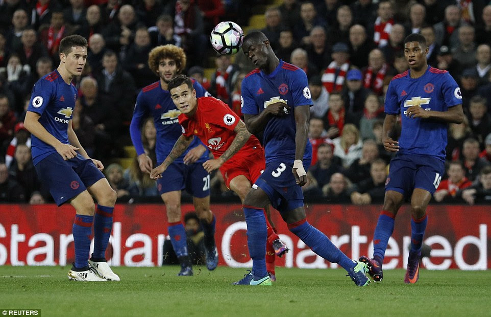 Philippe Coutinho (centre) strikes at goal to force a fantastic save from Manchester United keeper David de Gea