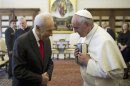 Pope Francis greets Israeli President Peres during private meeting at the Vatican