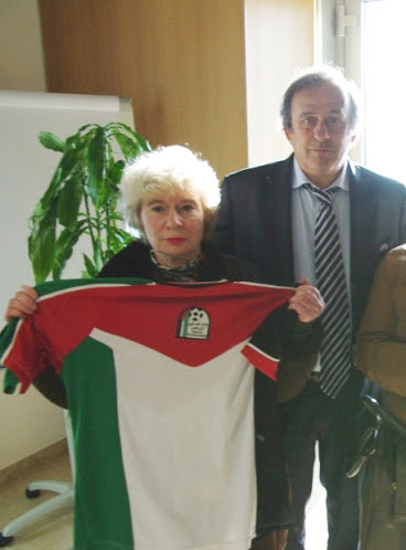 Michel Platini obliged to share the limelight with a Palestinian football shirt held by French campaigner Olivia Zemor