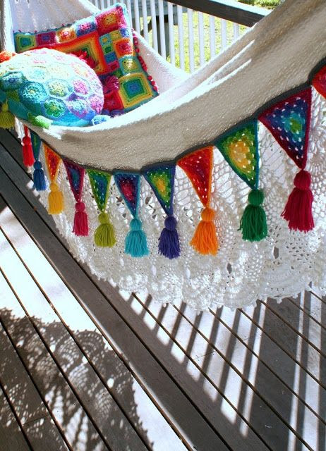 Edging a hammock with Granny Bunting Triangles. {How to create Granny Bunting Triangles found here: http://attic24.typepad.com/weblog/granny-bunting-triangles.html }