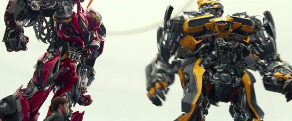 Bumblebee and a fellow (man-made?) Transformer in TRANSFORMERS: AGE OF EXTINCTION.