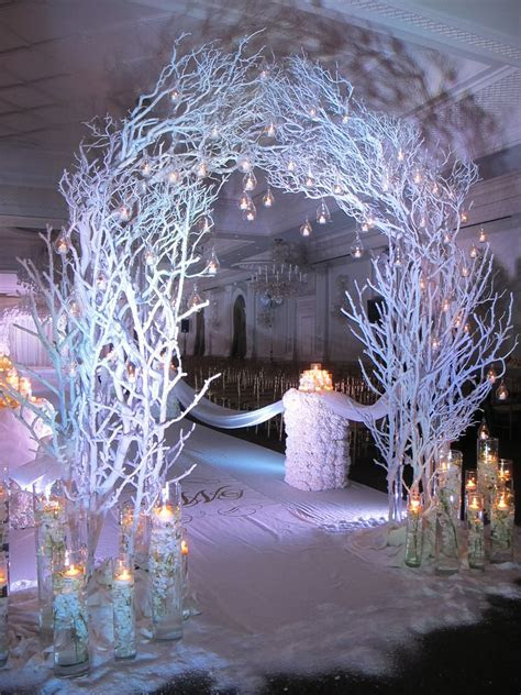 Stunning winter themed ceremony arch w/ candle accents