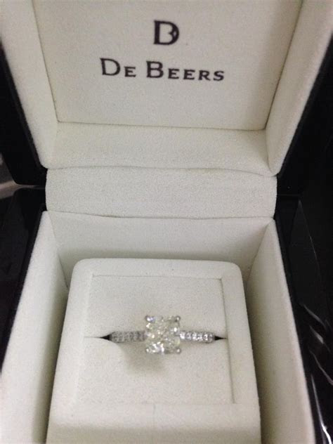 De Beers Classic Pave Solitaire Ring and De Beers Classic