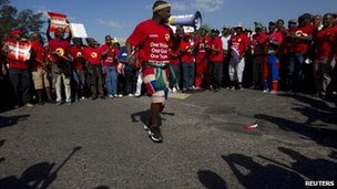 Members of the Nation Union of Metalworkers of South Africa sing as they continue to strike at the Toyota plant in Durban, August 23, 2013.