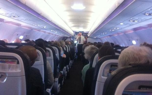 Passengers on a stranded plane at Christchurch Airport.