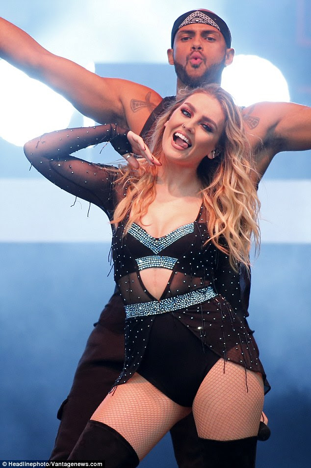 Sensual: Perrie and her backing dancer continued to dance erotically throughout the song