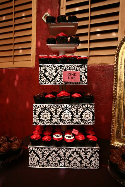 damask tower with dark red rosette cupcakes!