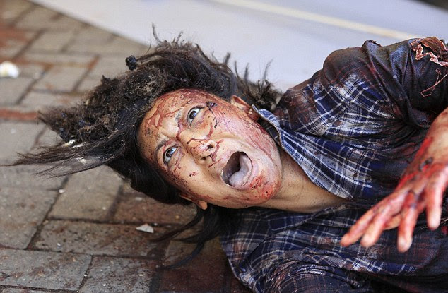 An injured woman cries for help after gunmen stormed the Westgate shopping mall in Nairobi