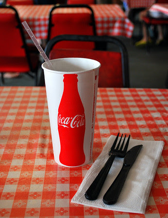 Keeping it simple - Coke in a paper cup and plastic utensils.
