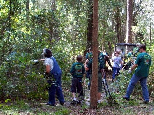 Volunteers clear trail.