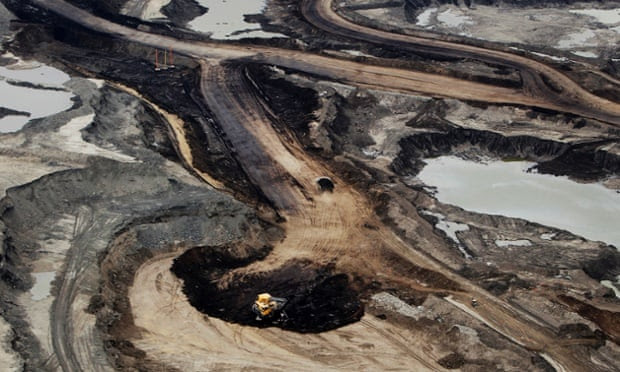 The Syncrude Canada Ltd. mine is seen in this aerial photograph taken above the Athabasca Oil Sands near Fort McMurray, Alberta, Canada, on June 19, 2014.