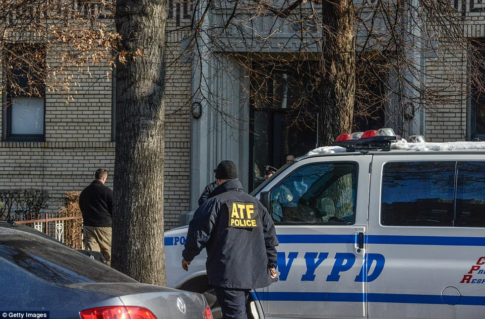 Police are seen at another address connected to Ullah in the Flatbush neighborhood of Brooklyn on Monday