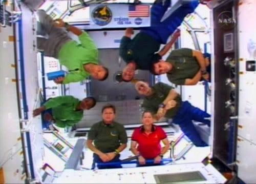 The crew of shuttle mission STS-120 gather inside the Harmony module a day after it was attached to the International Space Station.