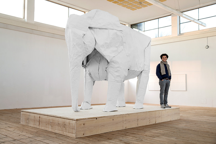 Artist Sipho Mabona Successfully Folds Life sized Origami Elephant from Single Sheet of Paper sculpture paper origami elephants