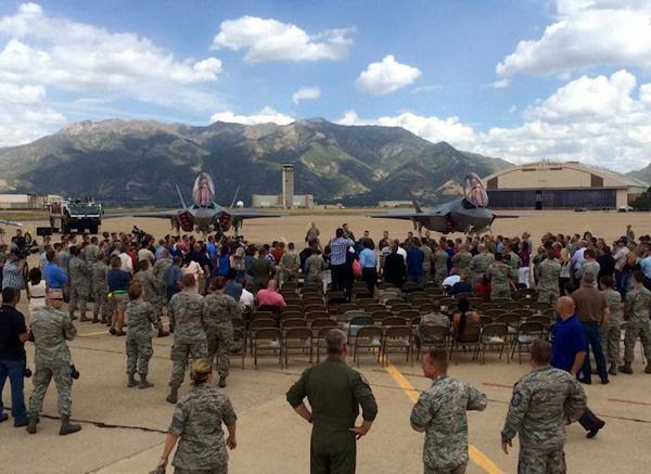 Military personnel gather for a press conference as the first two of 72 F-35A jet fighters are delivered to Hill Air Force Base in Utah...on September 2, 2015.