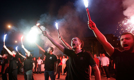 Supporters of the neo-Nazi Golden Dawn party celebrate their success in elections in Greece
