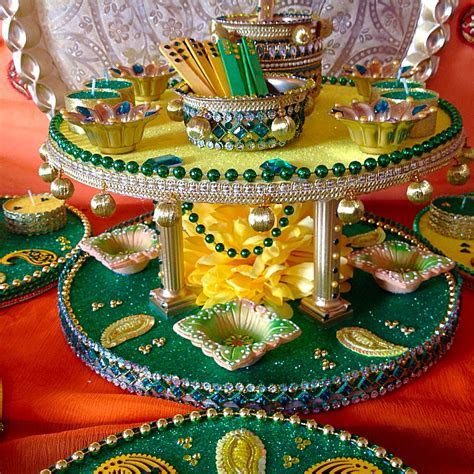 A double tiered Mehndi plate in traditional colours, an