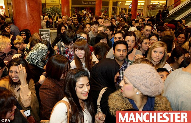 Crush: Shoppers at Selfridges in the Trafford Centre, Manchester, feel the squeeze