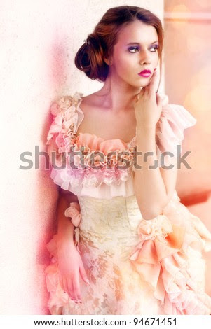 Young beautiful woman in vintage dress - stock photo
