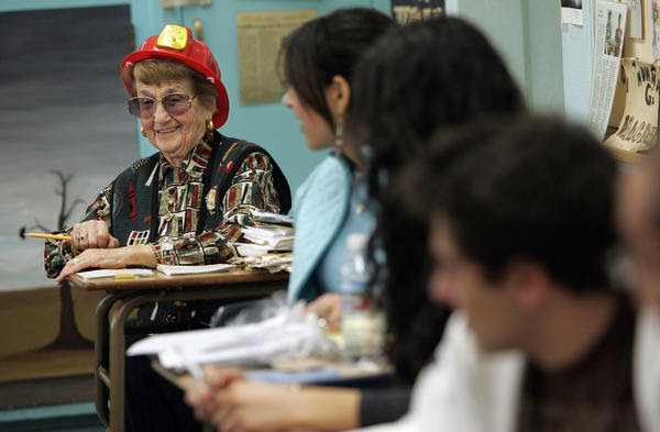 "English teacher Rose Gilbert, shown in the classroom in 2007, often wore a fire helmet to show her Pali High students that she was ""on fire."" Gilbert died Dec. 16 at age 95."