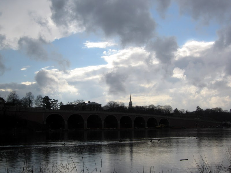 Clouds breaking over the river