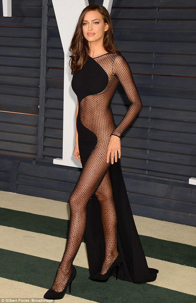 Hard to mesh: Irina Shayk arrived at the Vanity Fair Oscars bash in a very revealing gown on Sunday
