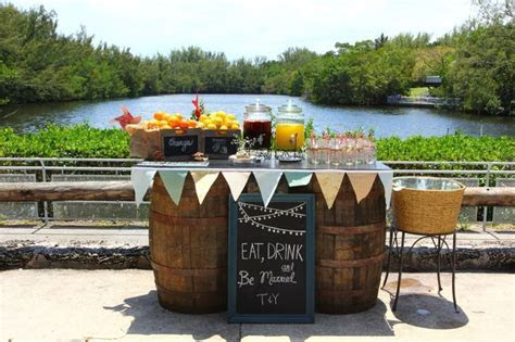 Sangria and juice bar display. Vintage wedding in