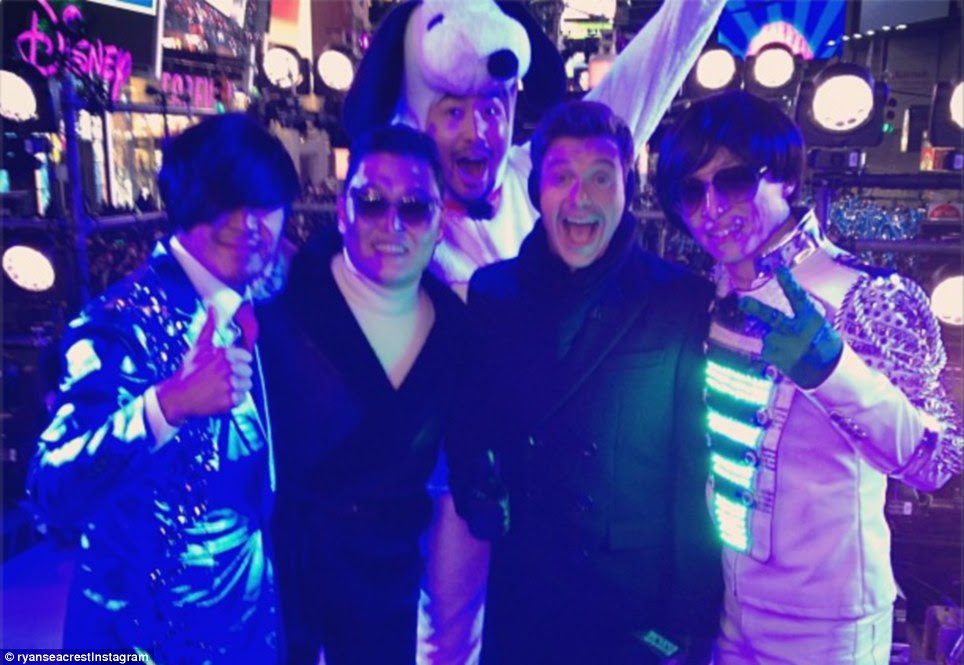 Happy birthday: Ryan Seacrest, center right, tweeted this picture and wrote 'Not a bad way to spend your birthday @Psy_Oppa!!'
