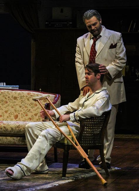 Brick, seated, and Big Daddy in IU Theatre's production of