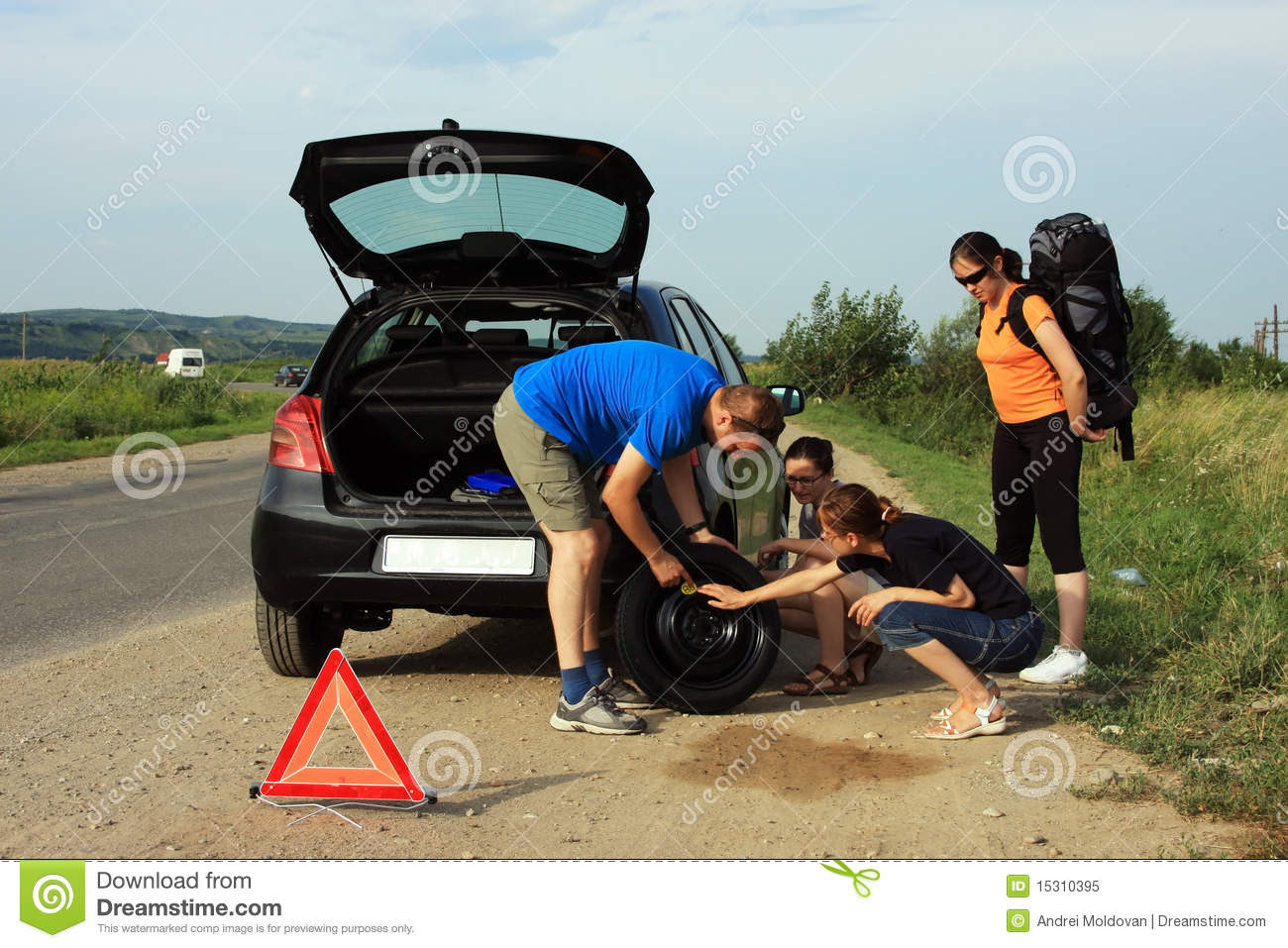 People Fixing A Flat Tire Royalty Free Stock Photo Image 15310395