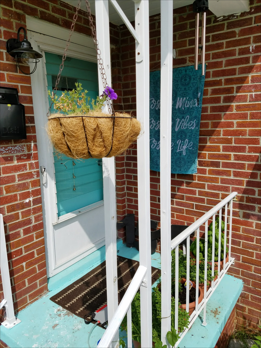 Brick home porch. Aqua front door - @adesignerathome