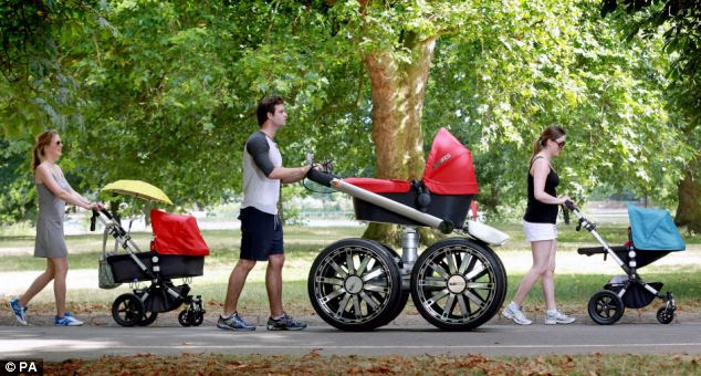 Nicholas Richardson pushes the 'vRS Mega Man-Pram' in London's Hyde Park
