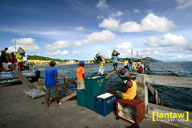 Offloading produce from nearby Alabat island