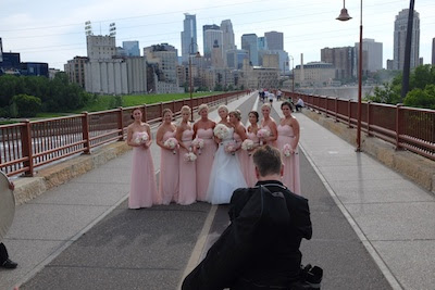 The Stone Arch Bridge is a popular spot for wedding shots.  Here's a group hoping the constant flow of goofball cyclists such as myself will die down for a minute.