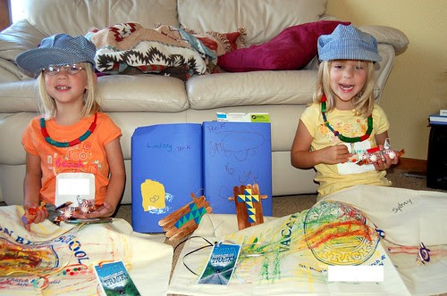Showing us their crafts from VBS..
