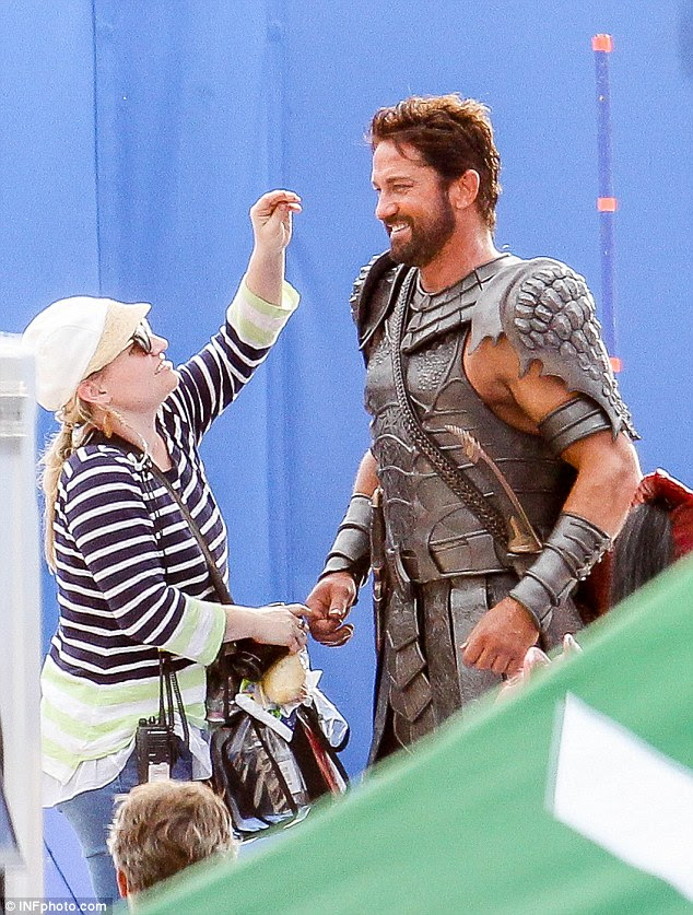 Up close and personal: Even gladiators need a touch-up now and then! Consummate professional Gerard is used to the ministrations of makeup artists on set