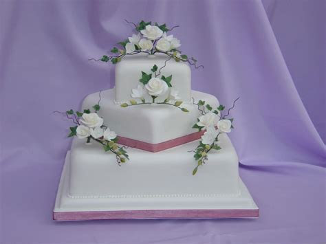 Square Wedding Cake With Roses And Freesias   Blueberry Cakes
