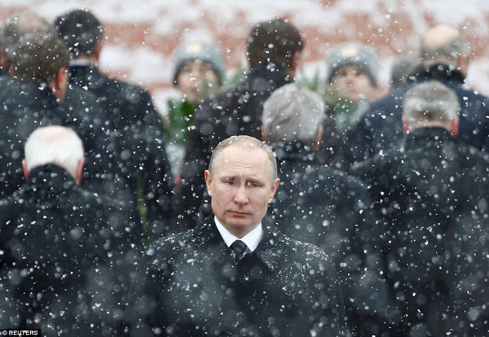 Russian president Vladimir Putin attends a wreath-laying ceremony to mark Defender of the Fatherland Day - a national holiday celebrating those who were or are serving in the Russian Armed Forces. He is pictured at the Tomb of the Unknown Soldier by the Kremlin wall in central Moscow on February 23