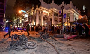 Thai soldiers inspect the scene after a bomb exploded outside a Hindu shrine in central Bangkok, killing at least 12 people and wounding 78.
