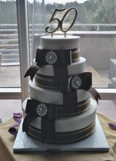 4 tier 50th Anniversary Cake multiple large bows (1