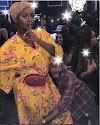 Asa Asika grabs his bae, DJ Cuppy legs